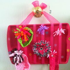 My sisters idea: $0.92 cookie sheet from Walmart, spray paint (already had), ribbons (had), and hot glue (had). Oh and some stickers to break up the pink. Hair bow/clip holder. :)