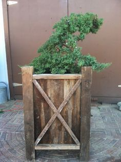 Cultivators Design and Landscape's reclaimed wood planter we made for a client.