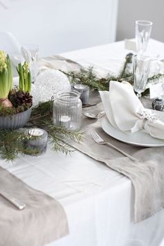 Christmas Table -- love white and linen or burlap used together. I will have to try using a simple cloth this way instead of placemats.