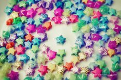 Origami Stars.  I would fill a vase with these to use as a centerpiece at home or for tokens in the classroom.