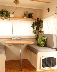 This 1969 Camper Receives a Chic DIY Revamp on a Tight Budget - Photo 4 of 8 - At the dinette, the b Caravan Renovation Diy, Caravan Makeover, Rv Makeover, Scamp Camper, Scamp Trailer, T4 Camper, Camper Trailers, Camper Table, Kombi Home
