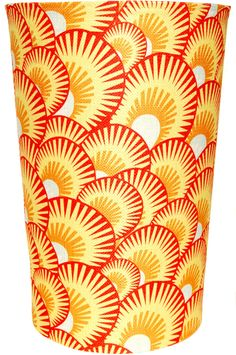 decorative waste basket in orange and white shell pattern.