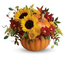 The air is getting cooler, the leaves are changing colors and the pumpkins are out in droves! Fall is most certainly here in New England and Clifford's would like to help you celebrate in style. Bring the pumpkin patch indoors with a hand-painted ceramic pumpkin filled with a rustic autumn bouquet. The bright autumn bouquet includes sunflowers, yellow cushion spray chrysanthemums, red daisy spray chrysanthemums, solidaster, huckleberry and curly willow. From $55.00