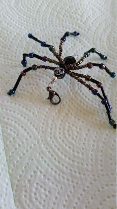 Glass Beaded Black Iridescent Spider Color : Black Iridescent, Silver  Size: 2 ½ inches  Made with Glass and Acrylic Faceted beads, Crystal
