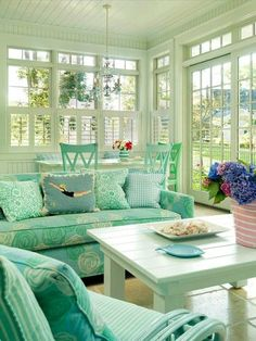 Mint Green Sofas in AIRY Window-Filled White Sun Room decorating idea design 6