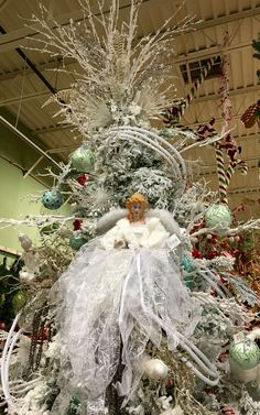 Snow White angel Christmas tree topper designed by Arcadia Floral & Home Decor