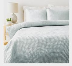 luxurious solid grey quilt for a sophisticated master bedroom