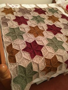 Star crochet blanket/afghan. Made using Aran weight yarn and a simple diamond shape stitched together to create the pattern .