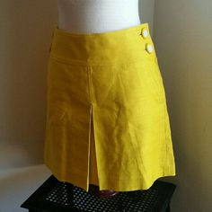 """J .CREW .........GORGEOUS YELLOW...SKIRT.... EXCELLENT CONDITION. ..NWT .......BRAND NEW  .......NO FLAWS... ........GORGEOUS ....... COLOR TRUE YELLOW. .........COLOR LOOKS STRONGER IN PIC THEN IN ........ PERSON... ........true to its size and color  ......2 PIC... WHITE BUTTONS ON SIDE FOR DECO. ...... zipper on side. .......on front opens as deco..but underneath..the ....... actual skirt is closed... .......LENGTH ...18"""".. .......better in person J. Crew Skirts"""