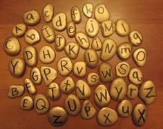 """Pirate gold alphabet stones - from Kindergarten: Holding Hands and Sticking Together ("""",) Great for Pirate Party - treasure hunt to find letters and unscramble for clue to find treasure. Preschool Literacy, Early Literacy, Preschool Ideas, Craft Ideas, Pirate Day, Pirate Theme, Escape Room, Pirates Gold, Pirate Activities"""