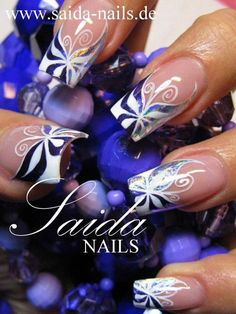 Image via Purple Galaxy Nails Art - how to paint stars on nails