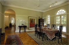 The dining room. The house's wood floors and high ceilings are typical of black and white houses. High Ceilings, White Houses, Singapore, Floors, Dining Room, Black And White, Wood, Kitchen, Home Decor