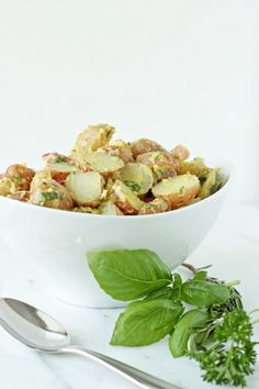 FRENCH POTATO SALAD  INGREDIENTS  2 ½ pounds fingerling or small new potatoes, halved (quartered if large) ¼ cup olive oil 3 tablespoons smooth dijon mustard 2 tablespoons cider vinegar 1 small shallot, minced (about 2 tablespoons) 2 tablespoons chopped fresh parsley 1 tablespoon chopped fresh basil 1 teaspoon chopped fresh rosemary s