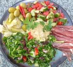 I made tabouleh last night, had a tomato and cucumber salad leftover from midweek, and a few other bits from the fridge and we have a really great Mediterranean Patter for dinner.  A perfect meal to share on the deck at sunset.
