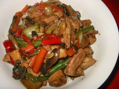 Chicken and Vegetable Stir-Fry - acid reflux recipes.  This recipe uses a minimal amount of vegetable oil, so you won't have to worry about heartburn that's triggered by regular frying. The recipe is also adaptable, allowing you to add more vegetables, or substitute those listed here for a few of your own favorites. #AcidRefluxRecipes