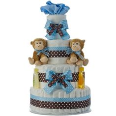This is a diaper cake for either a boy or twin boys. This one is made of diapers, 2 plush animals, Johnson and Johnson products, and blue and brown ribbon. A very unique gift for anyone who is having a baby. #diapercakes