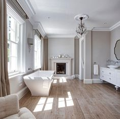 Bathrooms. French Bathrooms. Bathrooms This bathroom comes complete with fireplace, a free standing bath and wood-like floor tiles. #FrenchBathrooms #bathrooms Hayburn & Co.