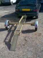 Foldaway Motorcycle Trailer rear view - it is supplied with loading ramp and ratchet strap tie downs.