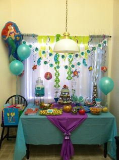 Ariel, Under The Sea Birthday Party! I made the banner myself. The Ariel pictures and balloon is from Party City. The sea weed is green tissue paper and a green party garland cut in half. The sea horses are made from paper plates (a tutorial I found here on Pinterest)