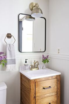 A small bathroom is made over into a classic, modern, rustic bathroom on a budget! Check out the before and after photos! Powder Room Ideas | Budget Bathroom Makeover