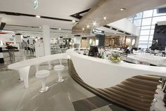 Corian® Benchtop curved to fit the design in this commercial environment.