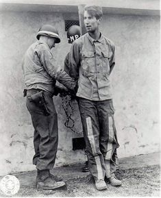 The executions at Henri-Chappelle, 23 December 1944.  During the Battle of the Bulge, Germans disguised in American uniforms infiltrated, trying to disrupt the Allied army.  For example, they altered road signs.  The penalty for wearing the other's uniforms in an attempt at subterfuge was death.