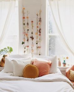 Check out these unique dorm wall decor items for your space! #dorm #dormroom #dormdecor #hangingflowers #plants #college #bedroom #sidetable #dormbedding