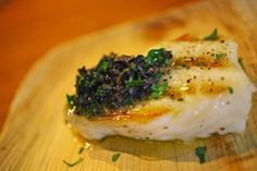 Sea Bass with Lemon and Capers~ 1 lb sea bass fillets, 1 lemon, 2 Tbs capers, rinsed, 2 sprigs fresh dill (dried may be used if fresh dill is unavailable), sea salt and freshly ground black pepper, Instructions~ Preheat oven to 350℉. Place sea bass fillets on a broiler pan. Thinly slice lemon. Sprinkle the fish with sea salt and freshly ground black pepper. Top with capers and dill sprigs. Cover with fresh lemon slices.