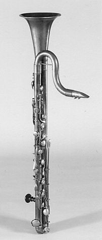Bass Clarinet in B-flat. Length (bell to bend at base): 853 mm. Diameter of bell: 157 mm. Length of tube (approx.) 1925 mm. Mouthpiece: 92 mm. Crook (approx.) 300 mm. Tube length left side of tube (bell end to bottom of bend): ca. 660 mm. right side of tube: 650 mm. Bell: 210 mm. Made after 1852; Olmutz, Czech republic