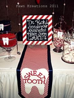"""Sweet tooth section of dental graduation party, with sign """"Dr. ______ needs your business. Have some candy!"""""""