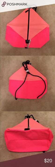 """Victoria's Secret Bag This pink & coral sling back style duffle is the perfect beach or overnight bag. Pic 1 is the front, Pic 2 the back & Pic 3 the bottom. Length is 11"""", height 15"""" and 7"""" wide. Victoria's Secret Bags"""