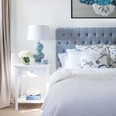 Blue is a definitive element of classic Hamptons design style, and it's often paired with crisp white and cool neutrals. Our chic duck egg blue linen buttoned bedhead captures the essence of Hamptons style and brings a calming relaxing element to your bedhroom. From Lavender Hill Interiors.