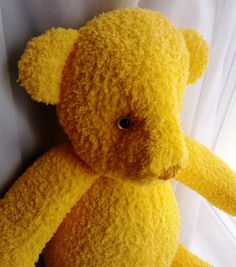 Handmade yellow teddy bear.