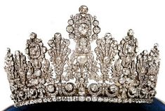 The Luxembourg Empire Tiara was first worn in 1919 by Grand Duchess Charlotte at her marriage to Prince Felix of Bourbon-Parma. Its origin was either through her grandfather's first wife Elizabeth Mikhailovna of Russia or her aunt Hilda of Baden. The tiara has descended to the current Grand Duchess Maria Therese.