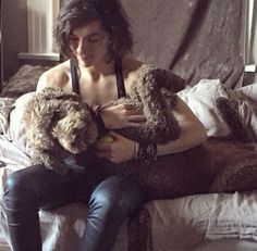 Emerson with his dog..omg I wonder where their dogs are...