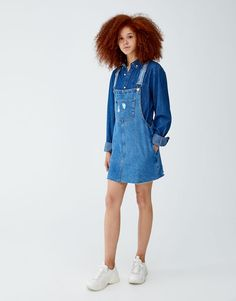 d6b013fff99e Denim pinafore dress with unfinished hem. Denim pinafore dress with  unfinished hem - PULL BEAR