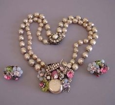 HASKELL  artificial pearls  two-row 14 necklace and 1 earrings with pink and clear rhinestones, rose  montee, pale blue and yellow glass beads all set in silver filigree. Marked  on back of necklace clasp and with the horseshoe mark on one earring..
