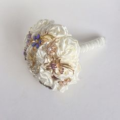 Ivory Fabric and Brooch Bouquet with purple brooches by Florio Designs