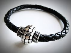 Silver Thai Style and Braided Leather bracelet by JewelryByMaeBee on Etsy.