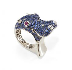 Sapphire, Ruby & Diamond Hippo Ring! The hippo is a powerful protector on land and in the water. Sapphire is the stone of destiny.  Exquisite 18k white gold setting. 251 shimmering blue sapphires, carat total weight 5.18; 2 precious rubies, carat total weight 0.15; 16 round brilliant diamonds, carat total weight 0.29. View online at http://tanarijewelry.com/catalog/rings/sapphire-ruby-diamond-hippo-ring