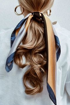 Silk scarf tied on curled pony tail, gold hoop earrings