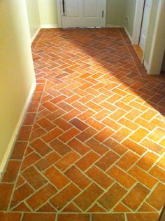 Herringbone brick tile hall floor, set in a border. Wright's Ferry tiles, in the Old Strasburg color mix.
