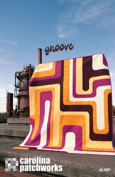 Trippy 'Groove' quilt designed by Emily Cier and quilted by Angela Walters using Kona solids.