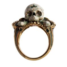 """Striking ring in yellow gold by master Venetian goldsmith Sigfrido Cipolato. Handcrafted and decorated with a green and black inlay using the ancient technique of cloisonné enamel, a method dating to the Middle Ages. The protagonist of the piece is, however, the glazed skull surrounded by 4 pink diamonds on the front, a design inspired by """"memento mori"""" jewels from the 16th century. Size is customizable."""