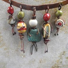 Tiny people pendants.  Inspiration for worry dolls made from beads and wire.