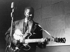 """Lonnie Johnson [Watch & Listen to Lonnie Johnson perform """"Another Night To Cry""""] [Listen to Lonnie Johnson's """"She's Only A Woman""""]"""