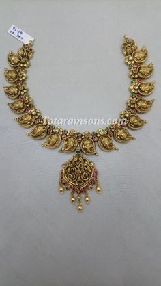 Exquisite Deep Nakshi Antique Vinayak Bridal Jewelry Now Available At Totaramsons.com Gold Jewellery, Wedding Jewelry, Beaded Jewelry, Jewlery, Gold Necklace Simple, Short Necklace, Gold Bangles Design, Jewelry Design, Antique Necklace
