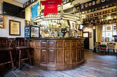 The Grey Horse Inn is one of Manchester's smallest pubs (the Circus Tavern two doors down is a little smaller. Consisting of a small round bar which bisects a small room, the pub still serves four beers from Hydes Brewery, the owner of the pub.