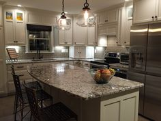 remodel small kitchen with under cabinet lighting subway tile backsplash and bianco antico granite