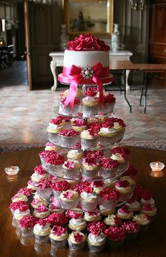 Hot Pink Wedding Cupcake Tower.  Could make it in blues & greens with sea shell decorations